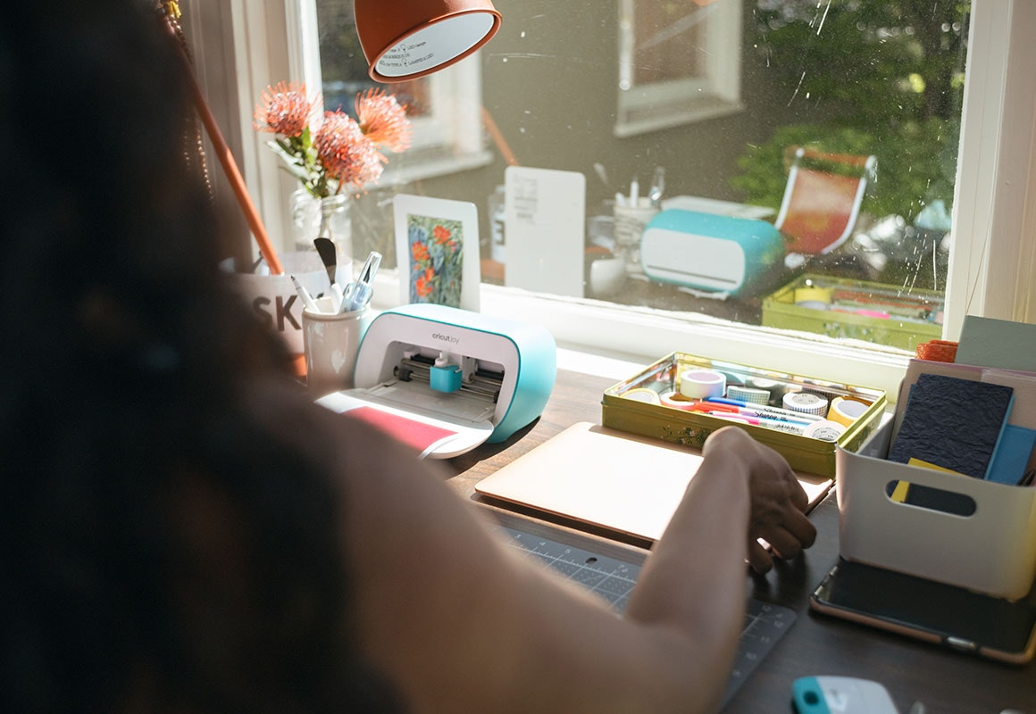 Woman working with the Cricut Joy