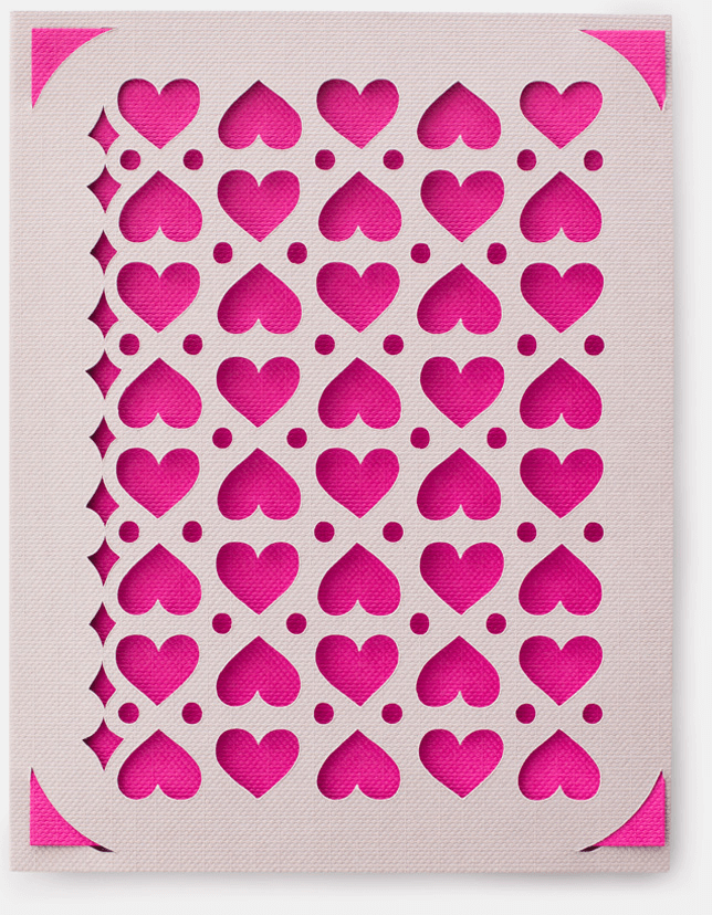 A pink and white card with a heart, circle, and star pattern on it.