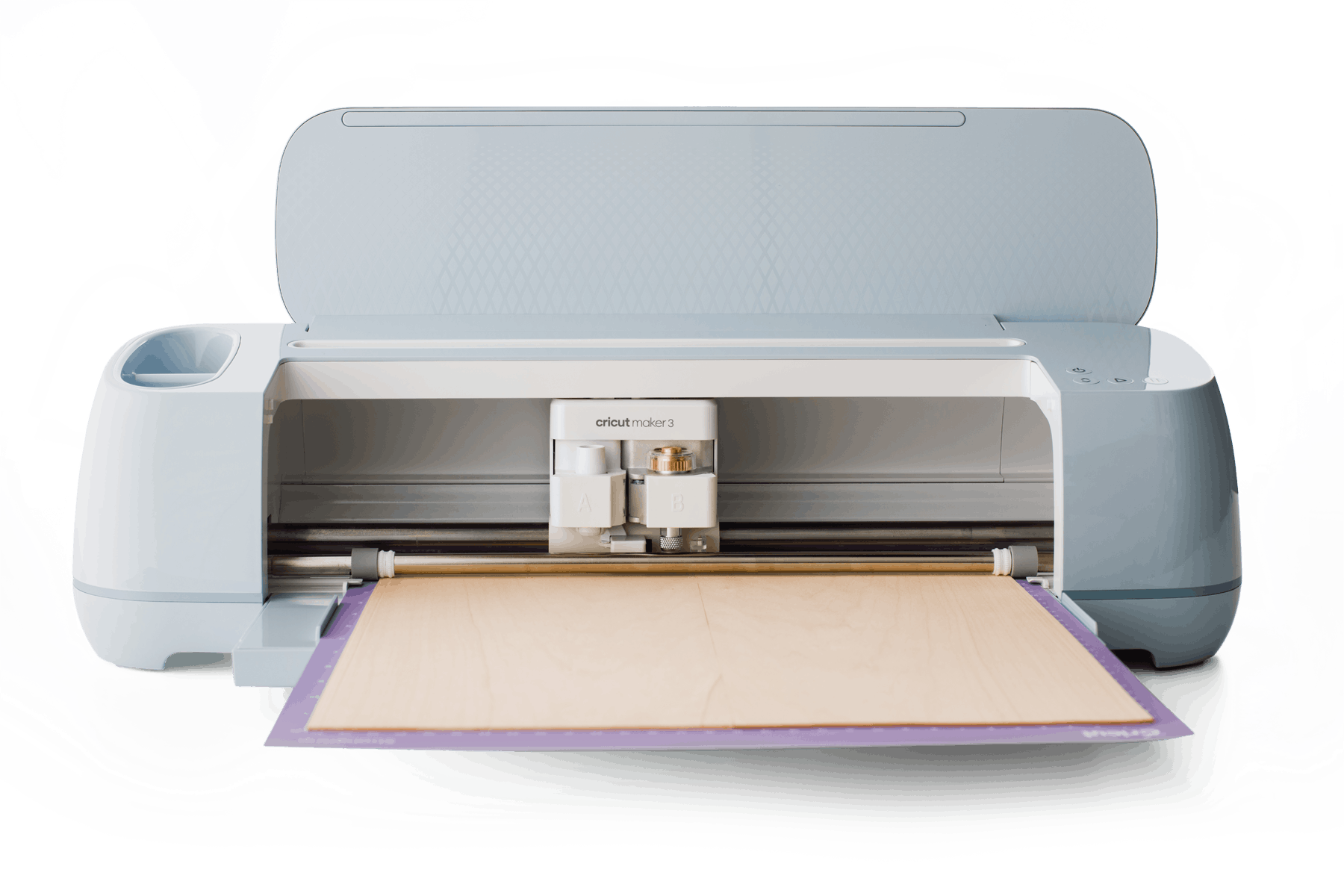 Cricut Maker 3 with basswood inserted on a cutting mat.