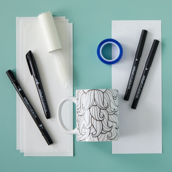 Supplies used to make a mug with Infusible Ink Markers.
