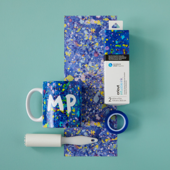 Supplies used to make a mug with Infusible Ink sheets.