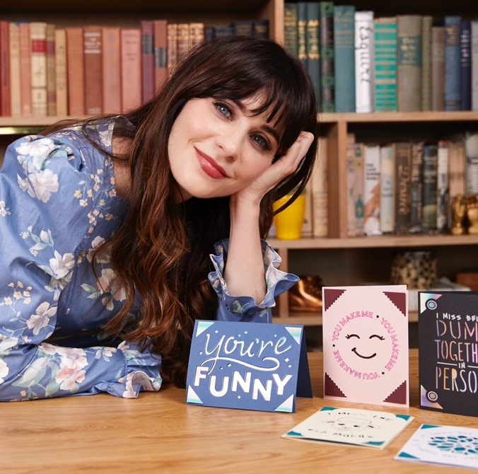 Zooey Deschanel displaying the cards she made with Cricut Joy