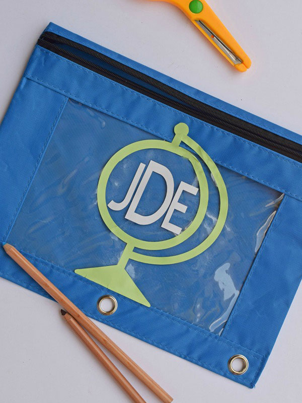 Add a cute globe and monogram to your child's pencil case