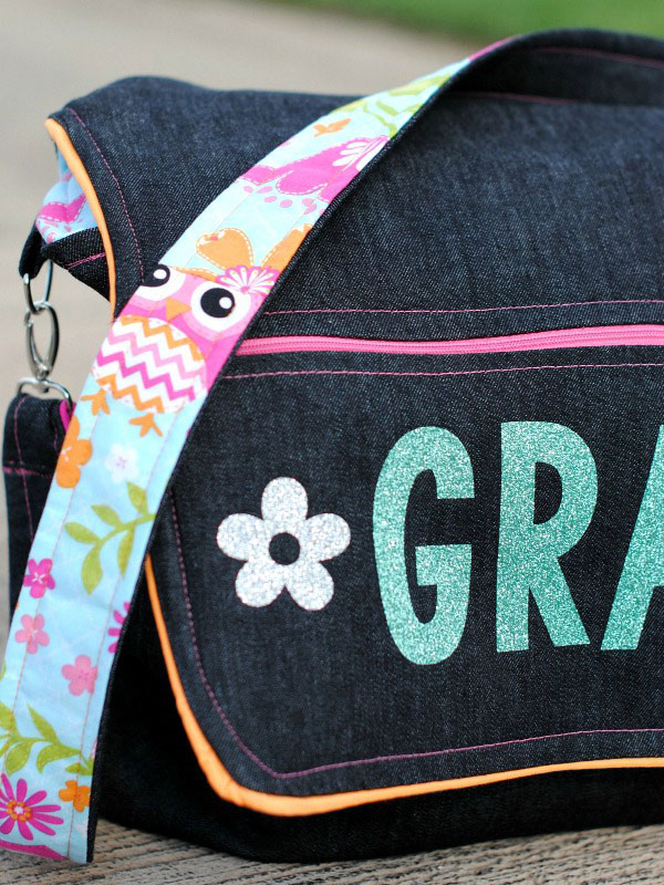 Decorate up your messenger bag with a Cricut