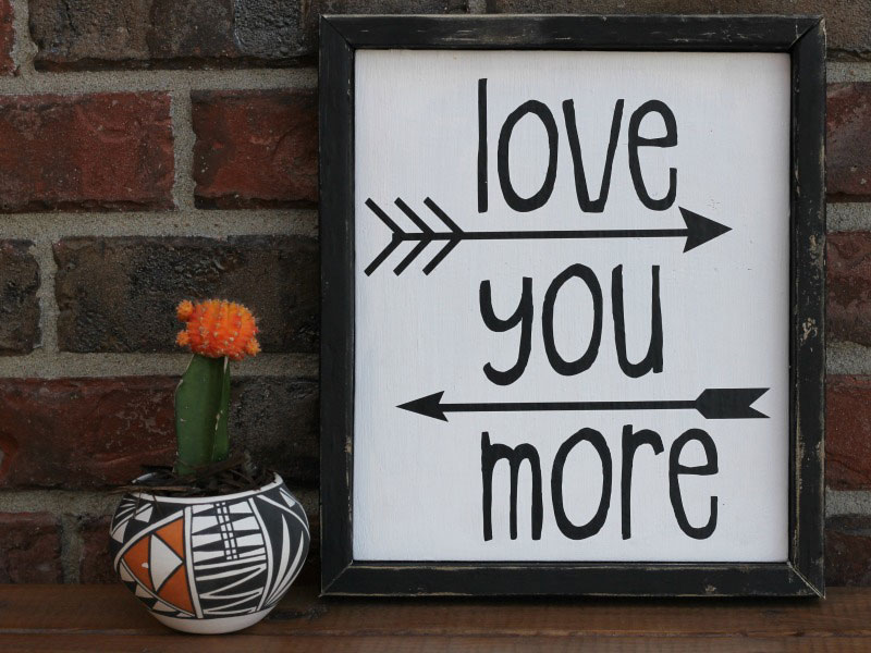 A cute Love You More sign