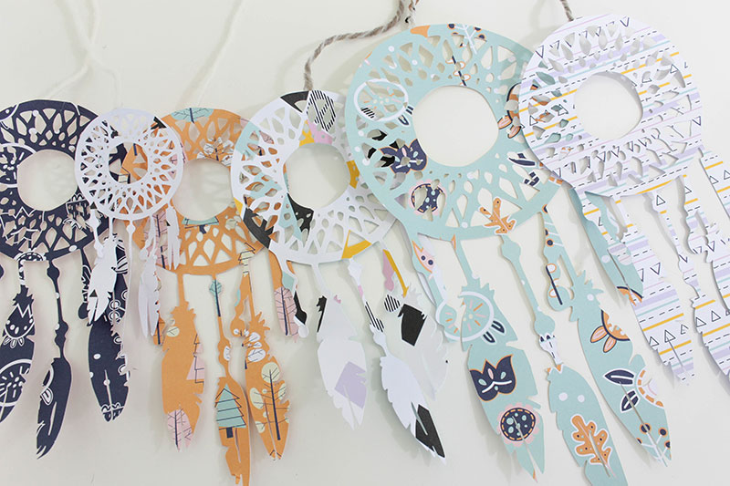 Cut out several different sizes of dream catchers