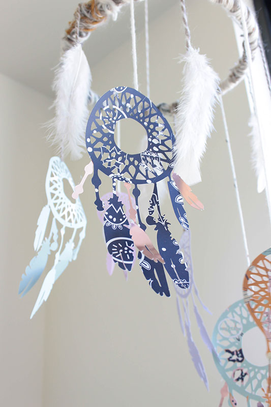 Gold foil accents on a dream catcher mobile