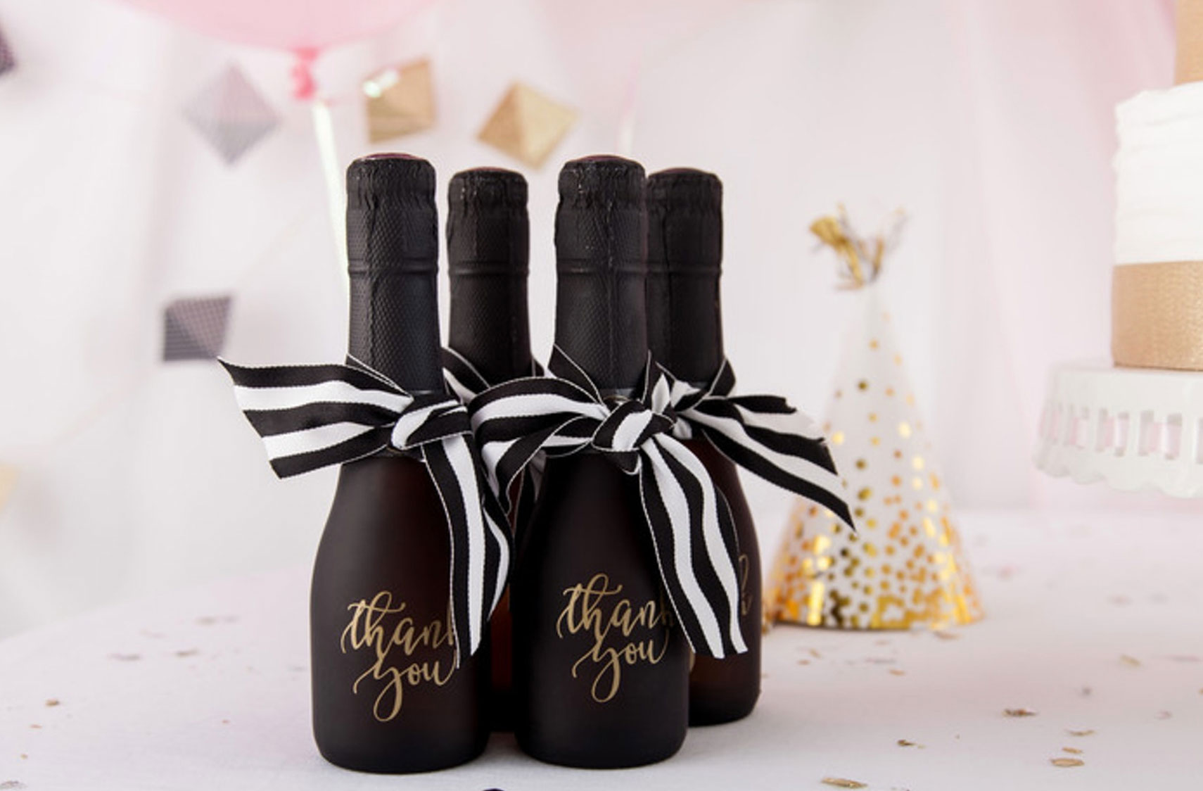 Give small champagne bottle favors as a thank you