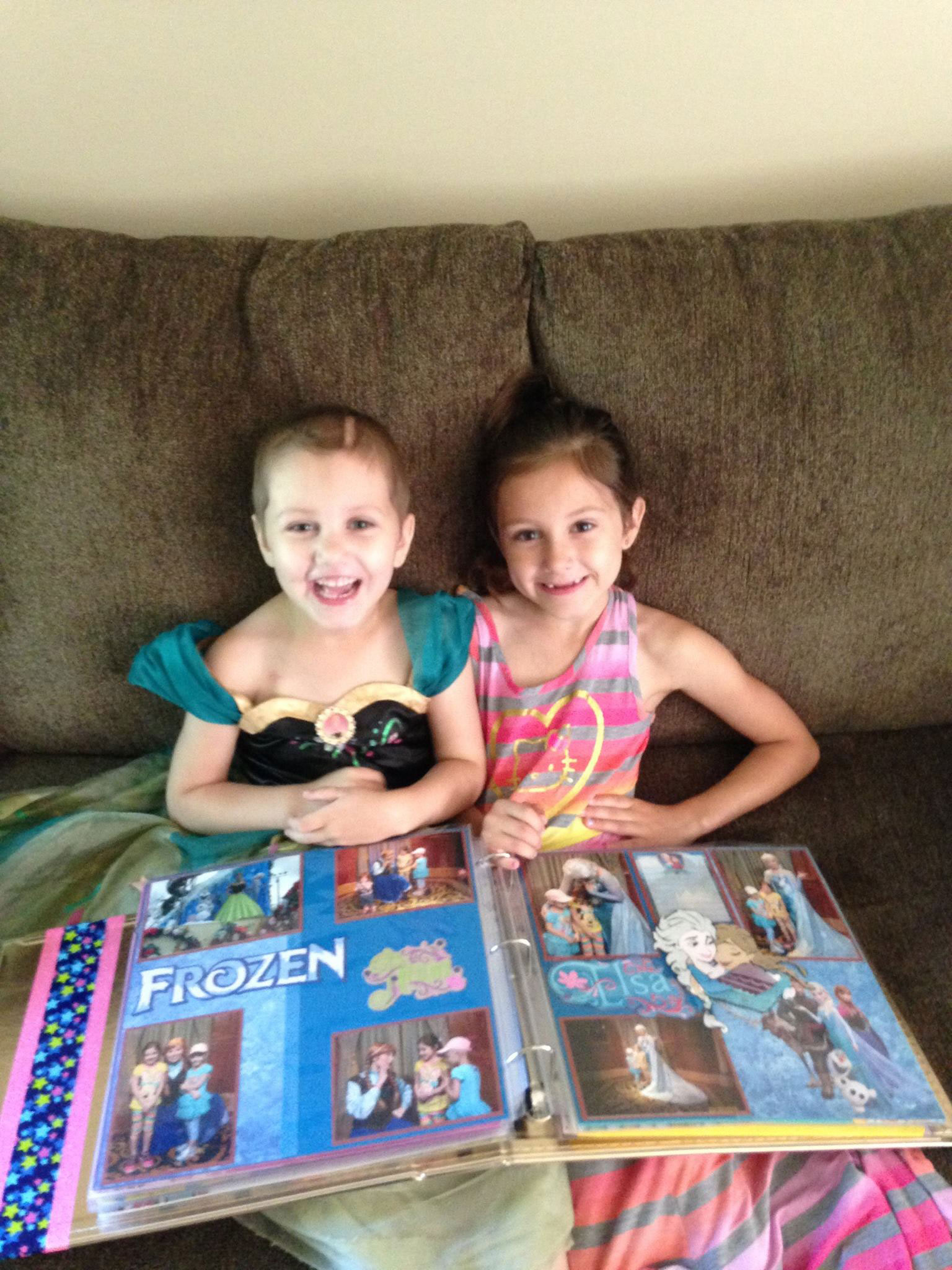 Happy girls looking at a scrapbook