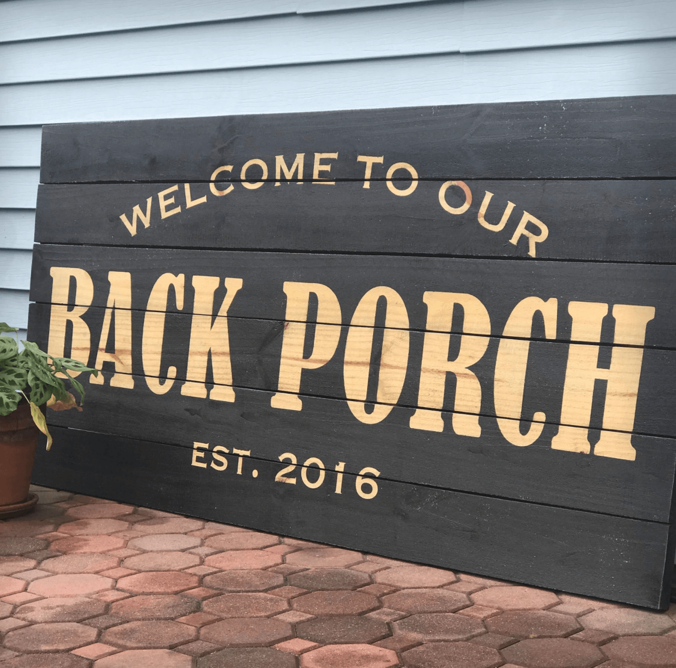 Back porch sign painted with reverse stencil